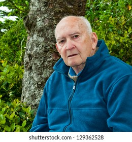 Portrait of serious senior man outdoors in sweater