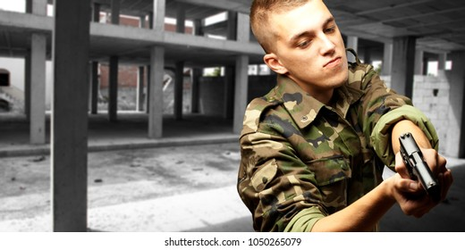portrait of a serious soldier aiming, outdoor