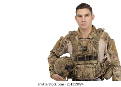 Portrait of serious soldier posing against white background