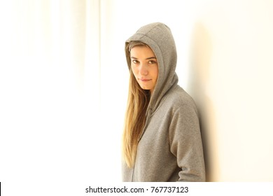 Portrait of a serious teen looking at camera isolated on white at side