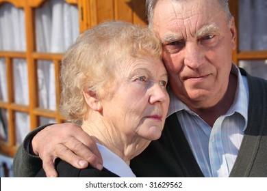 Portrait of serious thinking elderly couple closeup