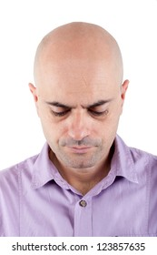 Portrait of a serious and worried  bald man looking down. Lilac shirt. Isolated.