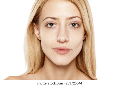 portrait of serious young blonde without make up