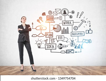 Portrait of serious young businesswoman standing with crossed arms and thinking over concrete wall background with business strategy sketch.