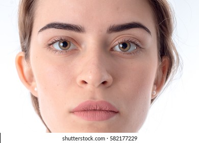 Portrait of serious young girl without makeup close-up