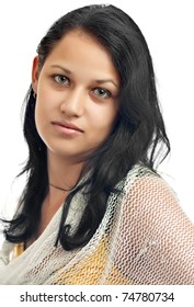 Portrait of a serious young latin  girl with beautiful green eyes isolated on a white background