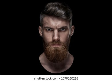Portrait of serious young man Isolated on black background and looking at camera Confident concep