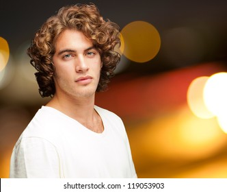 Portrait Of A Serious Young Man Standing, Outdoor
