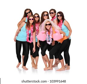 A portrait of seven sporty girlfriends having fun over white background