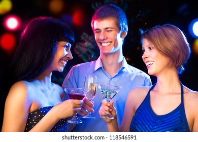Portrait of several friends celebrating Christmas