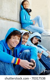 Portrait of several teens looking at camera while spending time outdoors