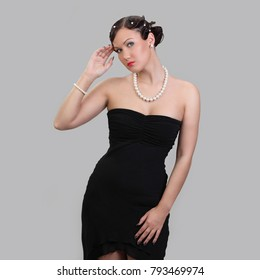 Portrait of sexual girl in black dress