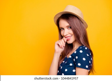 Portrait of sexy, adorable, nice, kind, pretty, lovely, professional woman, tour operator in polka-dot t-shirt biting her ginger, looking at camera with flirting expression