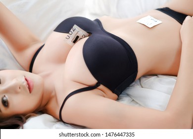 Portrait sexy asia woman with condom, safe sex concept