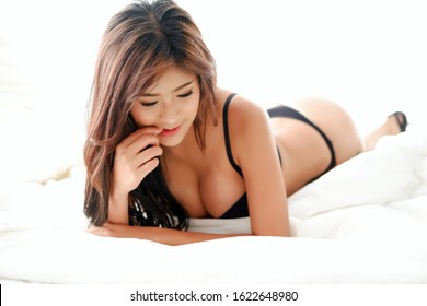 Portrait sexy asia woman wear lingerie or underwear lying on the bed