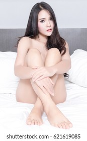 Portrait of Sexy Asian woman in bedroom
