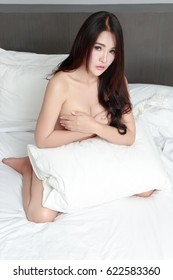 Portrait of Sexy Asian woman in bedroom, Sexy Asian girl concept