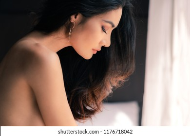 Portrait of sexy Asian woman sit and closing her eyes.