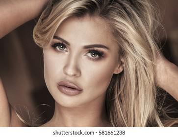 Portrait of sexy blonde caucasian woman in black bra.