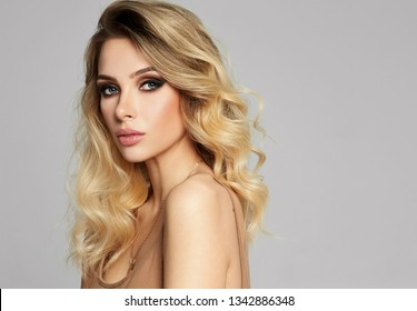 Portrait of sexy blonde woman with copy space