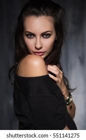 Portrait of sexy brunette showing her naked shoulder