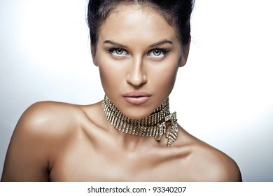 Portrait of sexy caucasian young woman with beautiful blue eyes posing on white background