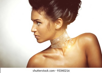 Portrait of sexy caucasian young woman with beautiful black hair posing on white background