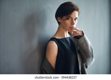 Portrait of sexy fashion woman on dark background