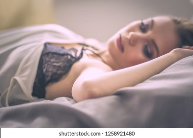 portrait sexy fashionable woman on the bed