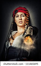 Portrait of sexy female pirate shooting from an old pistol