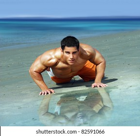 Portrait of a sexy fit male model on the beach