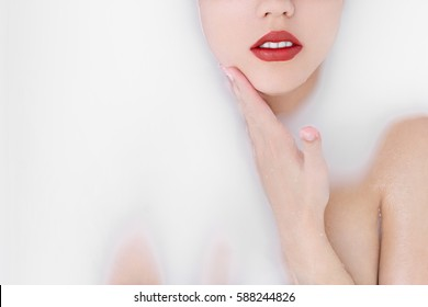 portrait of sexy girl in a bath with milk