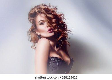 Portrait of a sexy girl in a black corset studio