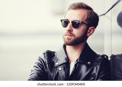 portrait of sexy handsome fashion male model man dressed leather jacket