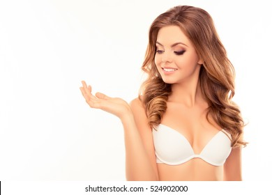 Portrait of sexy happy  woman in white bra showing her wrist