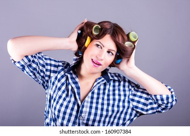 portrait of sexy housewife with curlers