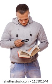 Portrait of sexy man reading book in library