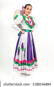 Portrait of a sexy Mexican dancer This girl is wearing a colorful dress used for regional dances held in the state of Aguascalientes, Mexico