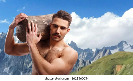 Portrait of a sexy, muscle brutal bearded man with haircut, with naked torso, holding a tree trunk on his shoulders, over alpine mountain background.
