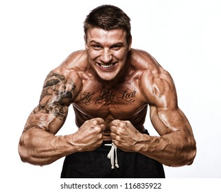 Portrait of sexy muscle man posing in studio