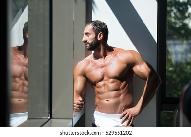 Portrait Of A Sexy Muscular Man In Underwear Looking Through Window