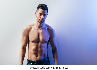 Portrait of a sexy muscular shirtless man with copy space