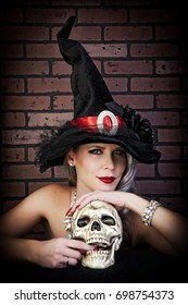 Portrait of a sexy pinup witch with skull.