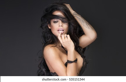 Portrait of sexy woman with black hair and glamour makeup.