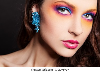portrait of sexy woman with bright multicolor makeup