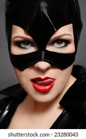 Portrait of sexy woman in catwoman black vinyl mask