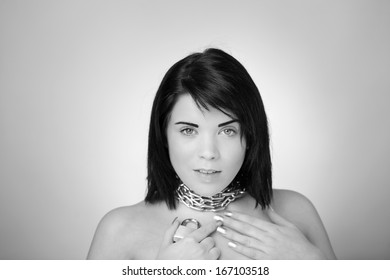 portrait of sexy woman with chain wrapped around her neck holding a pad lock