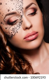 portrait of sexy woman with creative face art