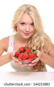 portrait of sexy woman holding strawberry