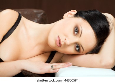 Portrait of sexy woman laying on couch